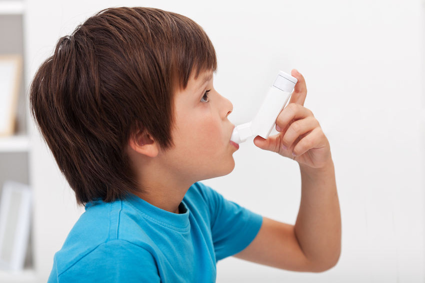 a boy using inhaler image