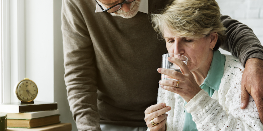 a couple taking medication image