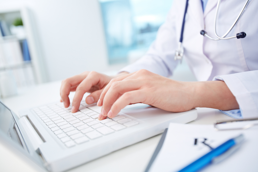 a medical professional at computer cb