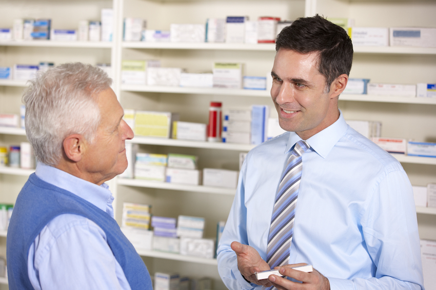 a pharmacist consulting with patient