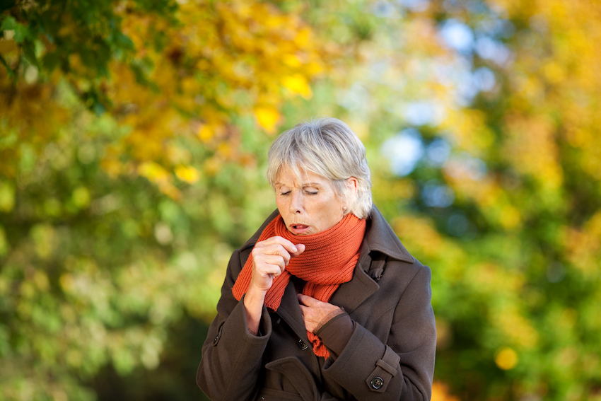 a woman coughing image